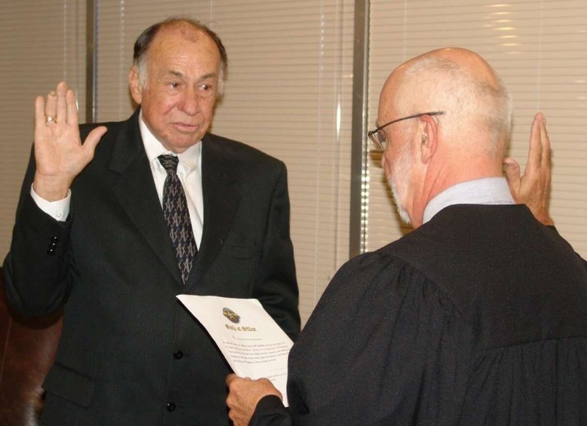 New District E Councilmember Leroy Stanley takes the oath of office from Judge Lester Rorick following his appointment to the seat.