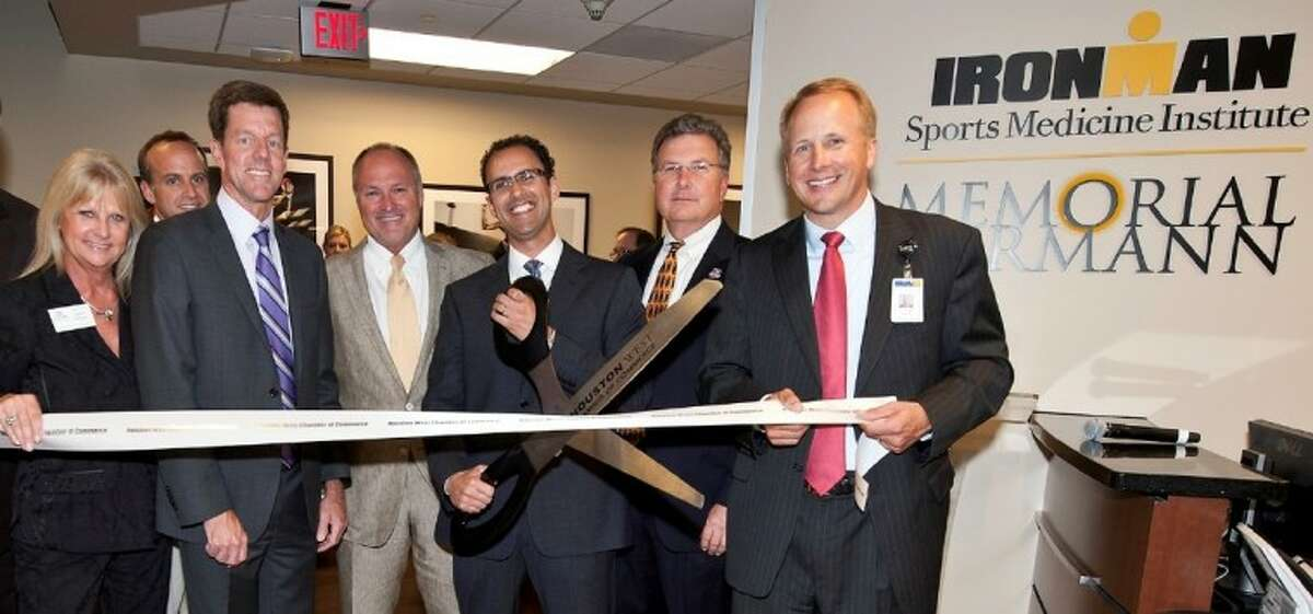Cutting the ribbon July 11 at Ironman Sports Medicine Institute at Memorial Hermann Memorial City are (from left) Jeannie Bollinger, president and CEO of West Houston Chamber of Commerce; Bill Potts, vice president of global licensing for World Triathlon Corporation; Dr. Walt Lowe, chairman of orthopaedic surgery at The University of Texas Health Science Center at Houston (UTHealth) Medical School and medical director of the Ironman Sports Medicine Institute at Memorial Hermann; Dr. Peter Sabonghy, director of the Memorial City location and a team physician for the Houston Rockets; David Bradshaw, chief information, planning and marketing officer for Memorial Hermann; and Keith Alexander, CEO of Memorial Hermann Memorial City Medical Center.
