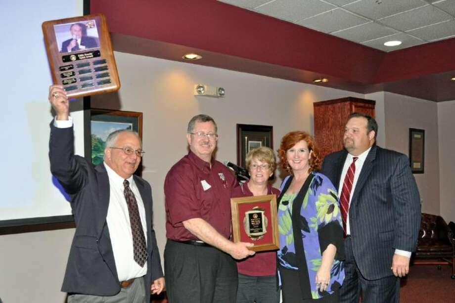 "Bay Area A&M Club members Dana and Bill Philibert received the coveted Romney E. ""Eddie"" Dansby Award. Pictured from left are President Joe Camarata, Mike and Joan Cade and recipients Dana and Bill Philibert. Photo: JACKIE WELCH"