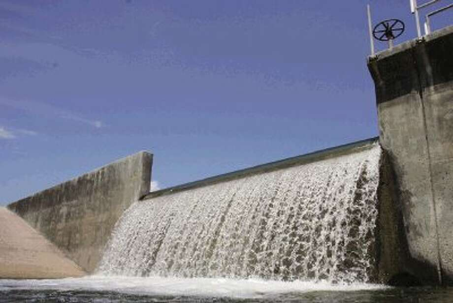Water from Lake Conrie is released Tuesday into the West Fork of the San Jacinto River to flow into Lake Houston. The initial release will be 50 million gallons a day, working up to 150 million gallons a day by Thursday.