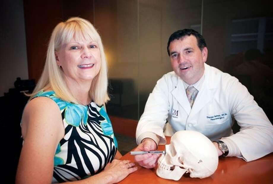 Daniel Yoshor, M.D., chief of neurosurgery at St. Luke's Episcopal Hospital and associate professor of neurosurgery at Baylor College of Medicine, shows Sheila Birenbaum how he removed a tumor at the base of her skull through her nose.