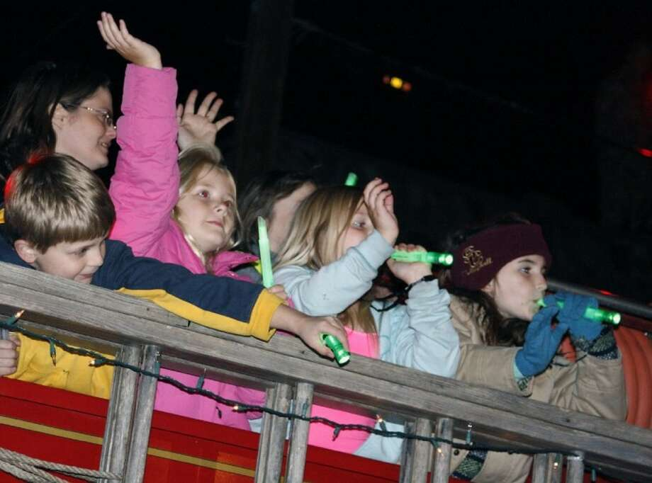 Antique fire trucks packed with kids are some of the floats usually involved in the annual Humble Christmas Parade. Organizers hope to have more people involved in this year's parade Dec. 4. Photo: JENNIFER SUMMER