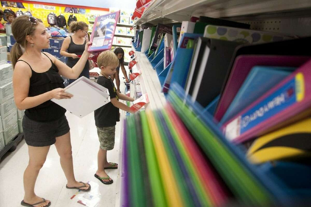 Amy Endraske helps her son Aden, 8, select school supplies at the Target in Meyerland on Friday afternoon.