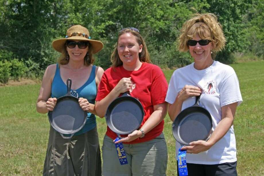 Women's Skillet Toss winners, from left, Monique Dermaux and Jennifer Mahan of Tomball, and Beverly Leitner of Katy.