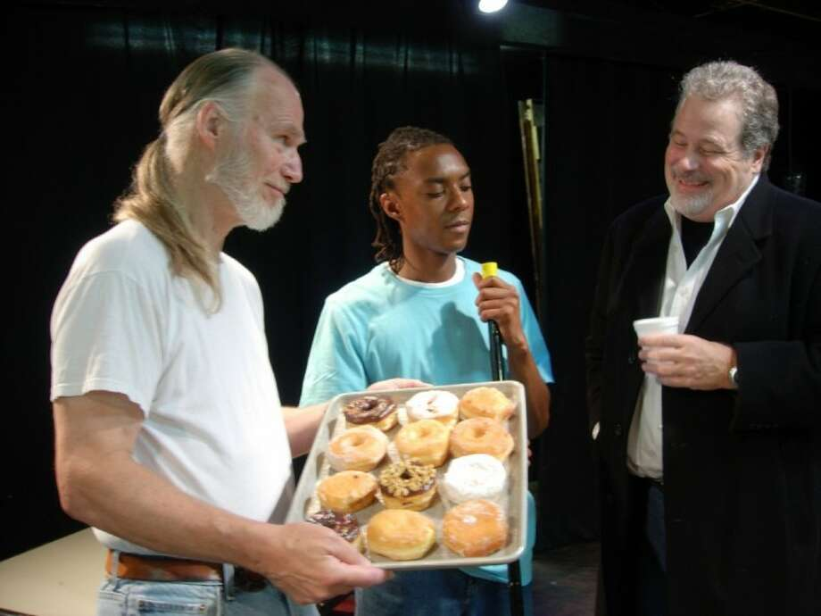 "Max (Scott Holmes) makes another attempt to buy the Superior Donuts shop from Arthur (John Stevens), while Franco (Sam Flash) listens with disapproval during a rehearsal of Theatre Southwest's production of ""Superior Donuts."""