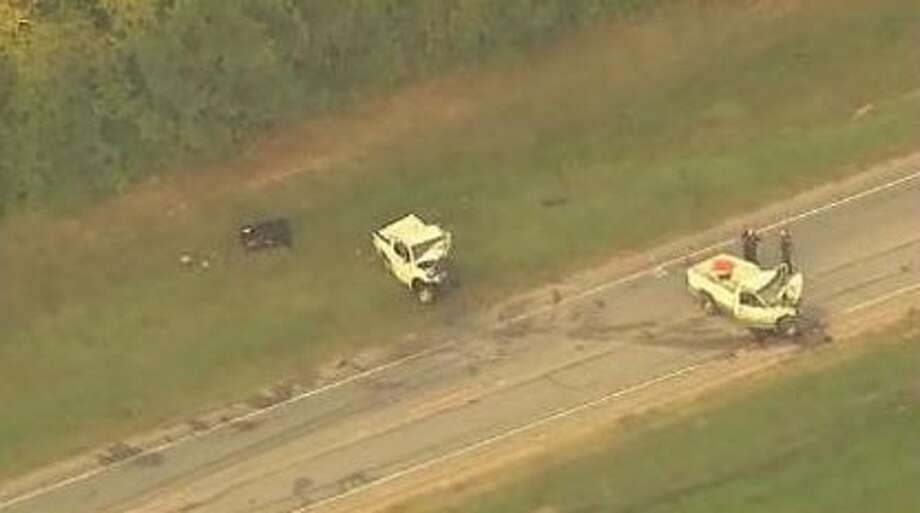 Two men were killed Aug. 9 when their pickup trucks collided head-on on FM 2100 in Huffman. (Photo courtesy ABC 13).
