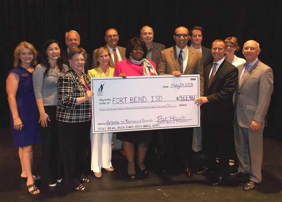 Pictured are Fort Bend Education Foundation Board Members (front row, from left): Brenna Smelley, Executive Director; Terri Wang, Board Member; Lynn Halford, Past President; Peggy Jackson, Board Member; Pat Houck, Current President; Charles Dupre, FBISD Superintendent of Schools; Jim Brown, Vice President of Allocations; Gary Dante, Board Member; and (back row) Dr. John Novak, Board Member; Dr. Dennis Halford, Board Member; John Wantuch, Board Member; Chris Hill, Board Member; and Kay James, Board Member.