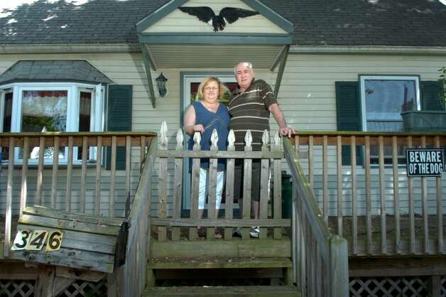 Judy And Jim Pepe Stand In Front Of Their Home On Funston
