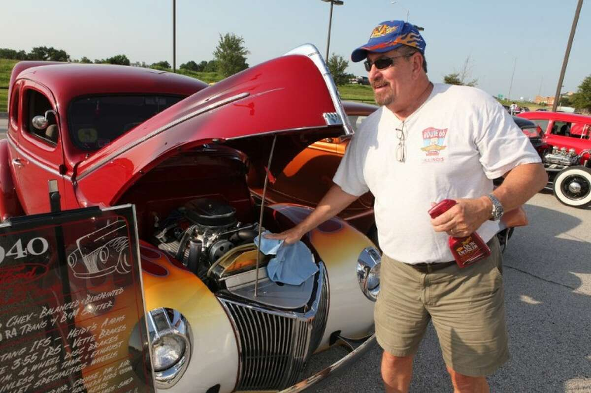Bill Heede of Fulshear shines up his 1940 Ford Standard Coupe Saturday at the Blast to the Past After Hours car show in Katy. (Photo by Alan Warren)