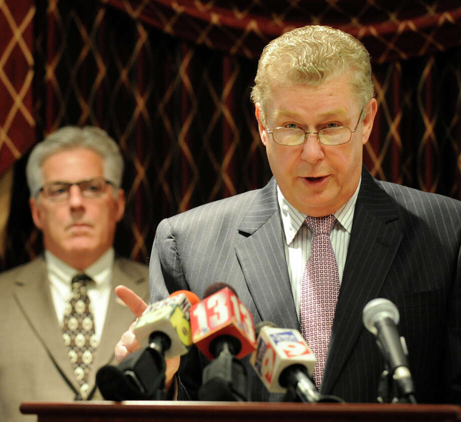 """Tom Wade, Rensselaer County Democratic Party Chair(r)  speaks during a press conference at the Hilton Garden Inn in Troy, New York about alleged improprieties in voting by the RENSCO Republican Party October 5, 2009.  In the background is Troy City Councilman Clem """"Chappy"""" Campana.(Skip Dickstein/Times Union) Photo: Skip Dickstein / 2008"""
