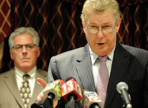 "Tom Wade, Rensselaer County Democratic Party Chair(r)  speaks during a press conference at the Hilton Garden Inn in Troy, New York about alleged improprieties in voting by the RENSCO Republican Party October 5, 2009.  In the background is Troy City Councilman Clem ""Chappy"" Campana.(Skip Dickstein/Times Union)"
