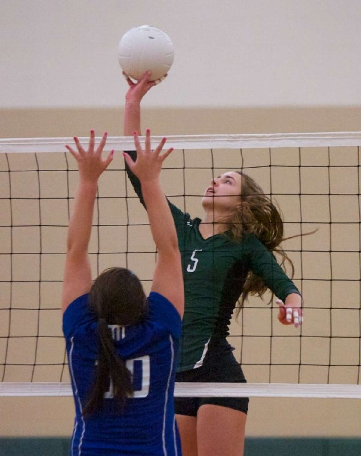 The John Cooper School's Margaret Connett goes up for a spike during Wednesday night's match against Lutheran North in The Woodlands.