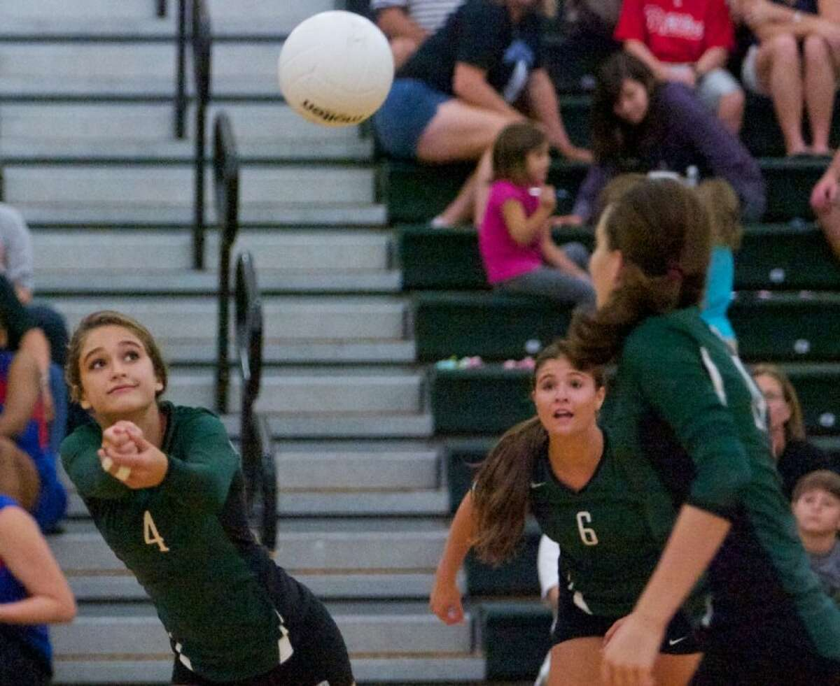 The John Cooper School's Christina Gooch digs the ball during Wednesday night's match against Lutheran North in The Woodlands.