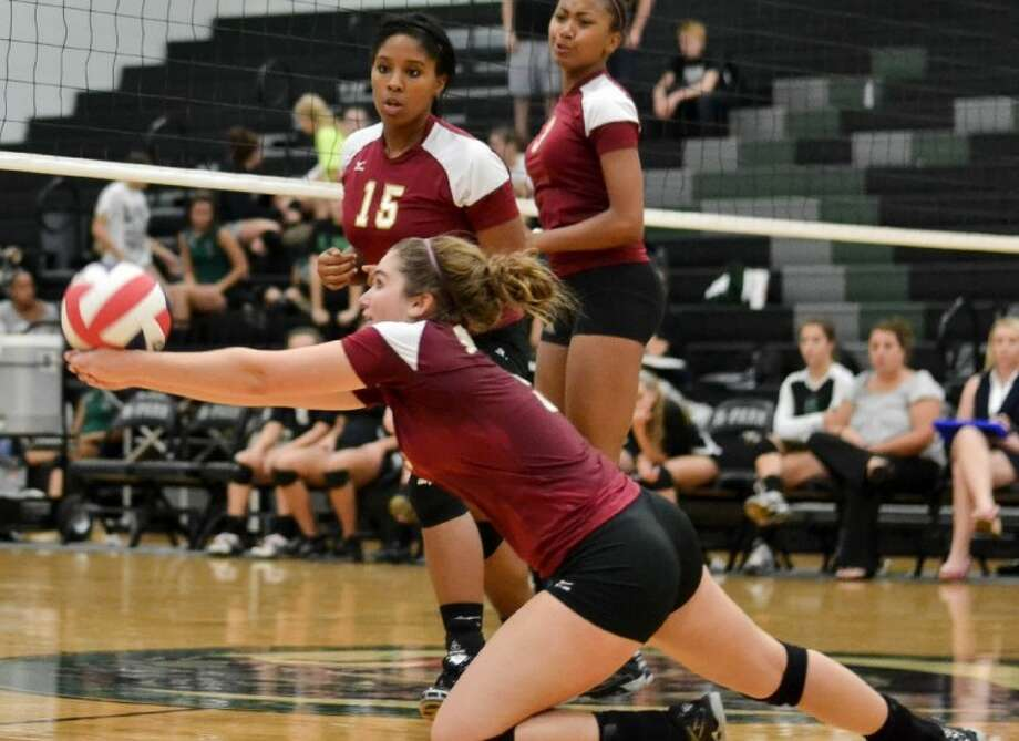 Danielle Miller dives to save an errant pass as Deja Alexander (15) watches in Summer Creek's match against Kingwood Park last year. In their first year under a new head coach, the Lady Bulldogs hope Miller and Alexander will be key parts of a playoff run. Photo: Stephen Whitfield