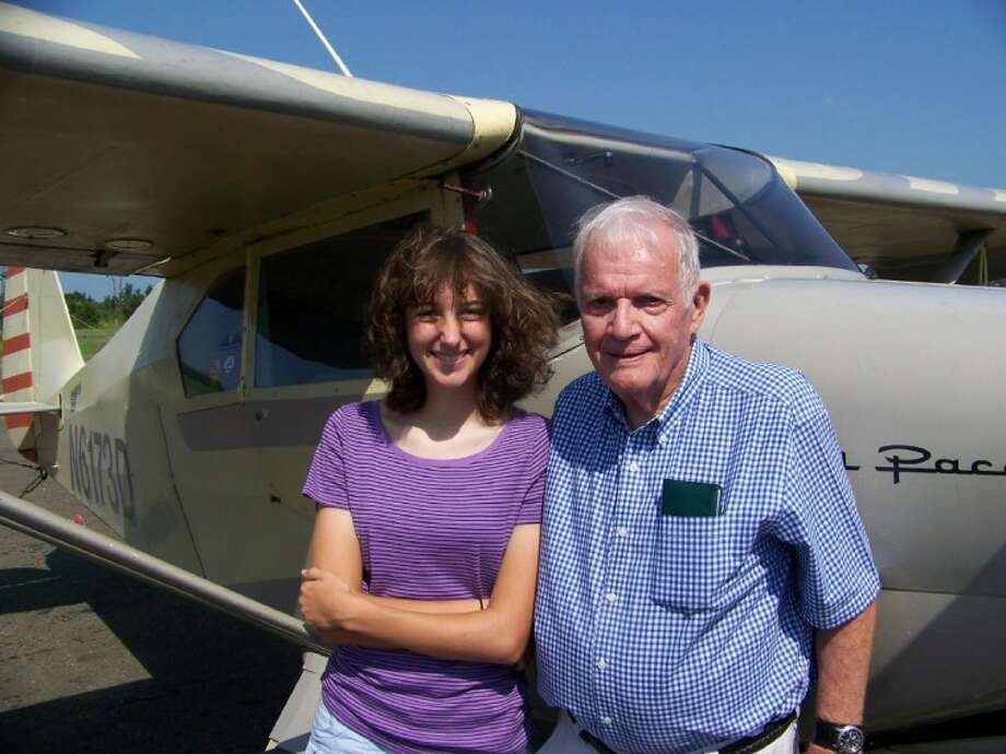 "Ellen Falterman, left, a senior at Tarkington High School, and William ""Bill"" Malone, a senior citizen who is 86 years old, recently received their pilots' license after training at the Cleveland Municipal Airport. Photo: Submitted Photo"
