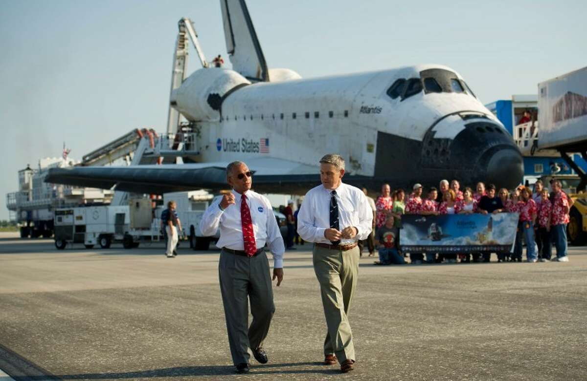 NASA Administrator Charles Bolden, left, and NASA Kennedy Space center Director Robert Cabana walk along the Shuttle Landing Facility (SLF) runway at NASA Kennedy Space Center shortly after the space shuttle Atlantis (STS-135) landed, completing its 13-day mission to the International Space Station (ISS) and the final flight of the Space Shuttle Program, early Thursday morning, July 21, 2011, in Cape Canaveral, Fla. Overall, Atlantis spent 307 days in space and traveled nearly 126 million miles during its 33 flights. Atlantis, the fourth orbiter built, launched on its first mission on Oct. 3, 1985. Photo Credit: (NASA/Bill Ingalls)