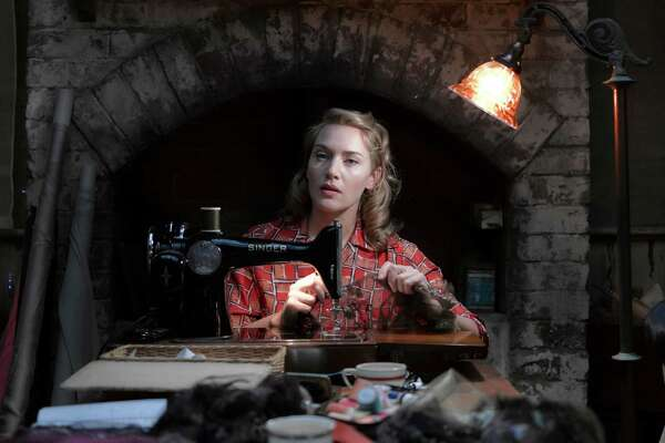 "This image released by Broad Green Pictures / Amazon Studios shows Kate Winslet in a scene from, ""The Dressmaker."" (Ben King/Broad Green Pictures and Amazon Studios via AP)"