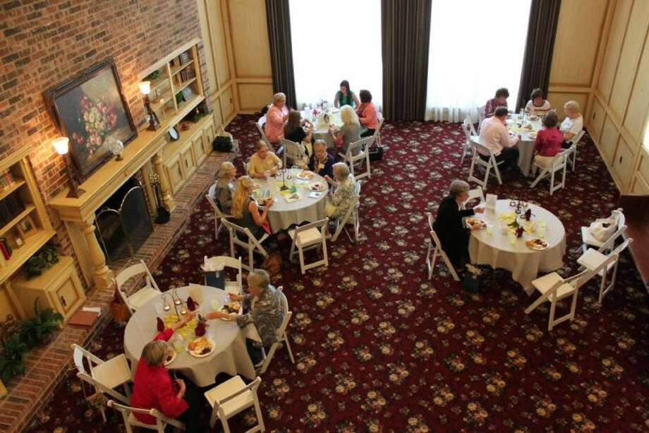 The ladies of the Tomball study Club dine in the Great Room at Ashelynn Manor in Magnolia.