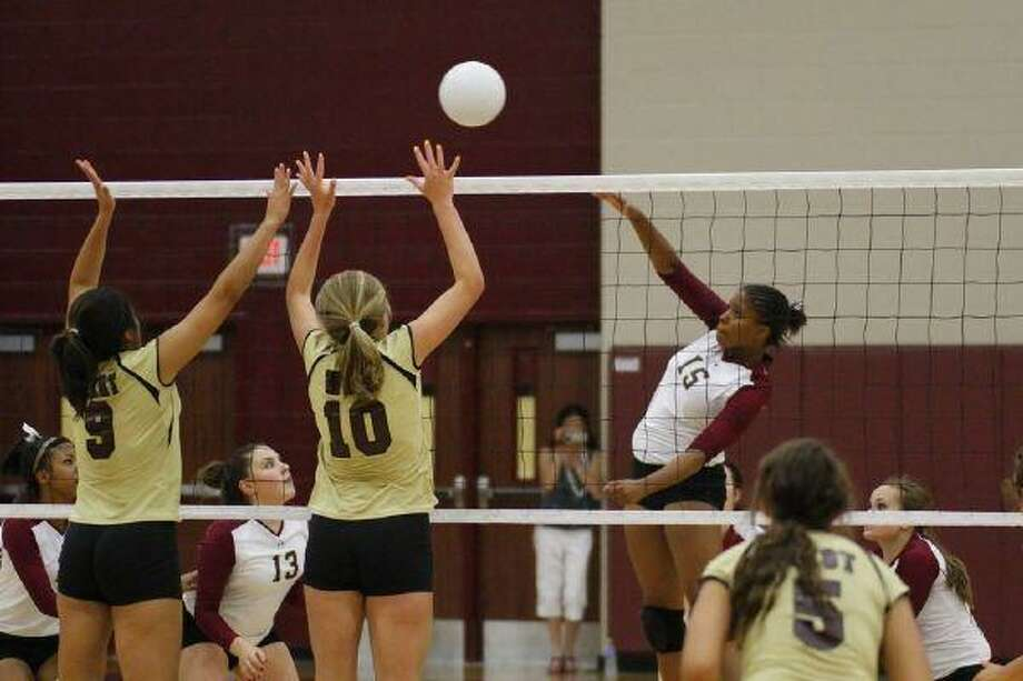Summer Creek middle blocker Deja Alexander goes for a kill in the Lady Bulldogs' 3-0 loss to Magnolia West Aug. 10 (Photo by kjwesphotos.com)