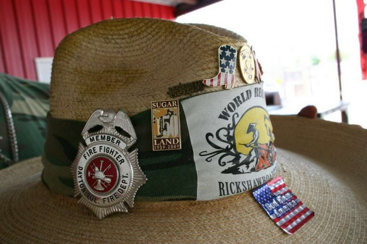Allie Stevens, also known as the Rickshaw Man, received a badge from the Dayton Volunteer Fire Department, which put him up for a while Aug. 21. Pulling a rickshaw from California to Florida, the Marine Corps veteran of the Vietnam War has been pressing onward to a world record rickshaw walk.