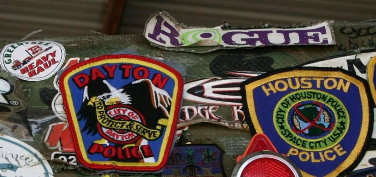 Allie Stevens, also known as the Rickshaw Man, has patches from law enforcement agencies and other entities attached to the rickshaw that he has been pulling from California en route to Florida. Having arrived in Dayton Aug. 21, the Dayton Police Department patch became one of them. The Dayton Volunteer Fire Department gave him a badge as a memento as well as a rest stop.