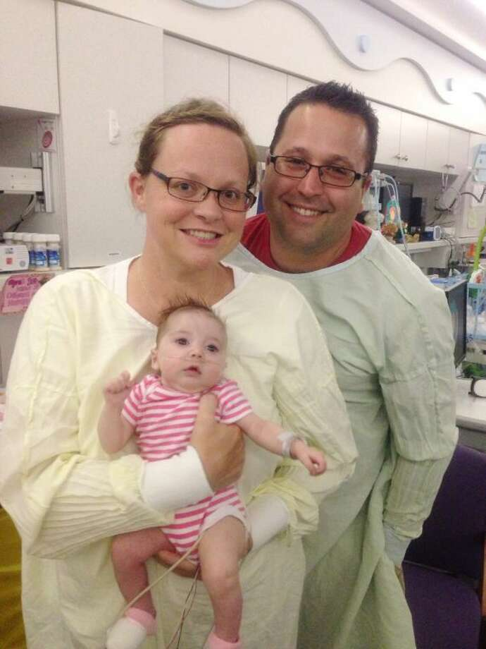 "Erica and Nathan Nigrelli with ""miracle baby"" Elayna."