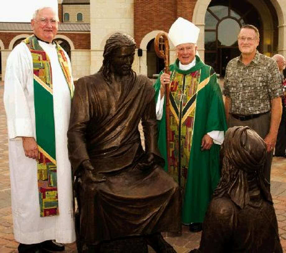 Msgr. Borski, Retired Bishop Rizzotto & Mike Kaney with statue of Jesus and Mary Photo: Charles Falk / Charles W Falk
