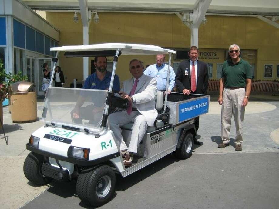 Galveston Mayor Lewis Rosen and Tony Napolillo, Sun Club program manager, take the first ride in the solar-powered cart.