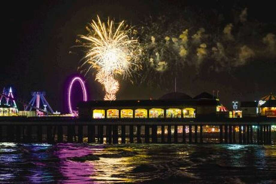 Fireworks will be shot off over the Gulf of Mexico in Galveston on July 4. Pictured is Galveston's Pleasure Pier.