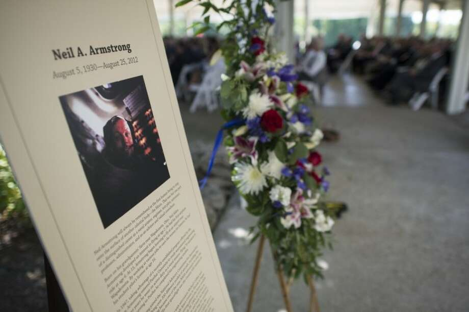A memorial tribute from the Smithsonian is seen at the entrance of a private memorial service celebrating the life of Neil Armstrong, Aug. 31, 2012, at the Camargo Club in Cincinnati. Armstrong, the first man to walk on the moon during the 1969 Apollo 11 mission, died Saturday, Aug. 25. He was 82. Photo Credit: (NASA/Bill Ingalls) Photo: NASA/Bill Ingalls