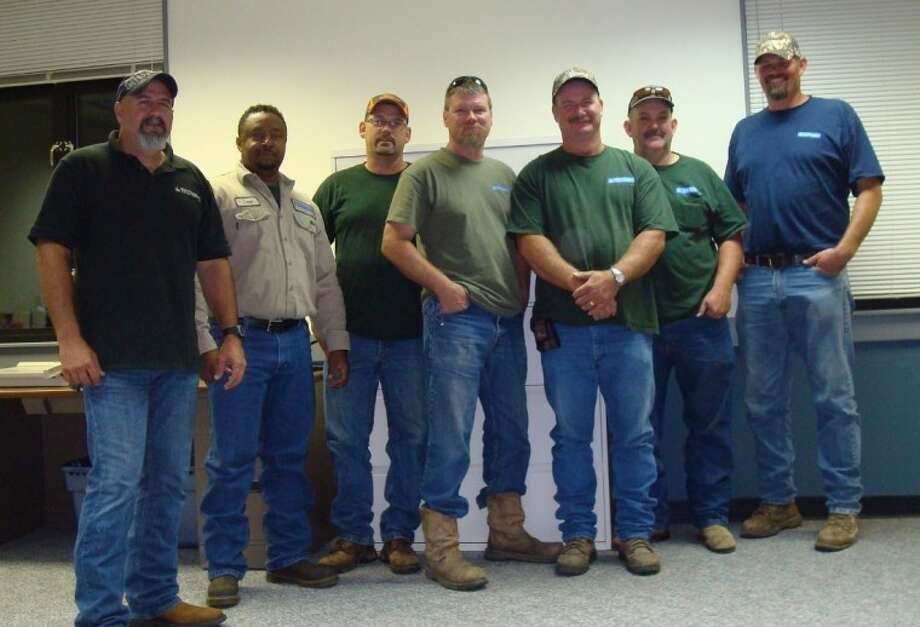 Sam Houston EC sent a recovery assistance team to Washington - St. Tammany Electric Cooperative in Franklinton, LA. The team includes, left to right, Mike Garess, Craig Barlow, Kirby Shepherd, Randy Campbell, David Boaen, Doug Walding and Terry Lowe.