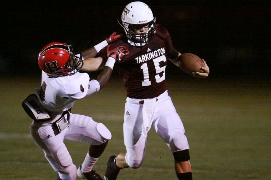 Tarkington's Hunter Johnson gives a hard stiff-arm to this defensive back from Huntington as he nears the sideline after a 25-yard run in the Longhorn's 36-12 week one victory over the visiting Red Devils. Photo: MARK ANDERSON