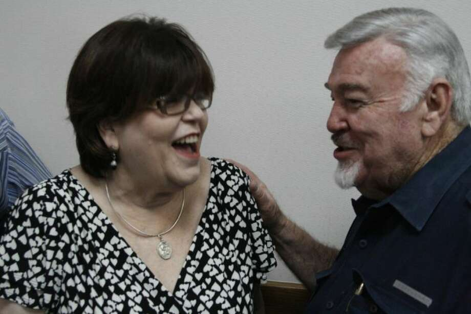 Retiring City of Humble City Secretary Sue Daniel chatted with former City of Humble Council Member Bill Conner at her retirement party June 28, 2013.