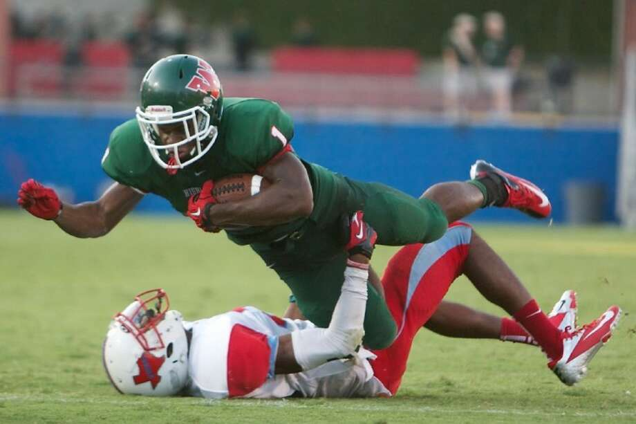 The Woodlands' Patrick Carr flies over a Dallas Skyline defender during a game at Pizza Hut Park in Frisco last season.