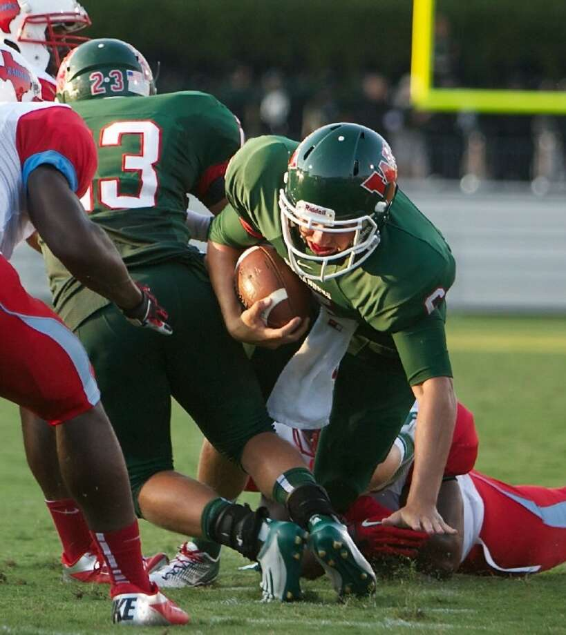 The Woodlands quarterback Blaine Gillespie leads his team against Hightower on Friday night at Woodforest Bank Stadium.