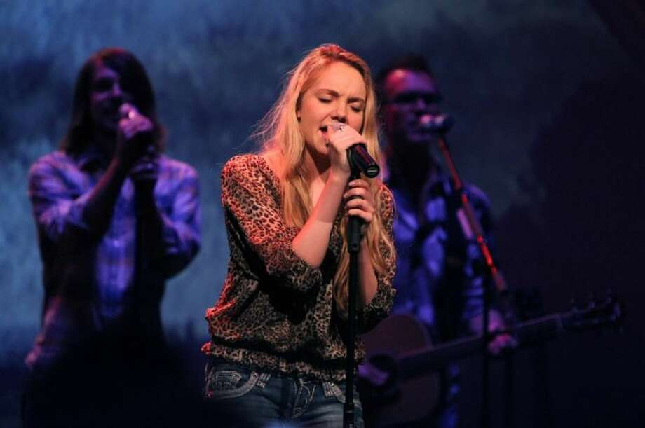 "Danielle Bradbery sings at Community of Faith Church in Cypress on Saturday. The event marked her return home after winning the title of ""The Voice."""