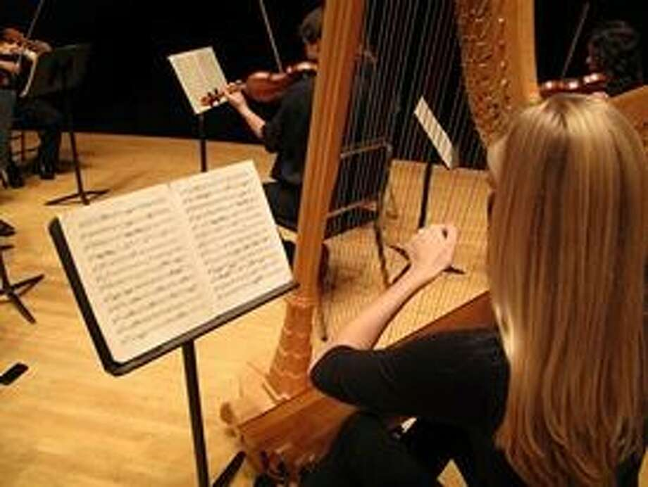 Members of the Cypress Symphony are busy tuning up for their inaugural concert scheduled for Sept. 21.