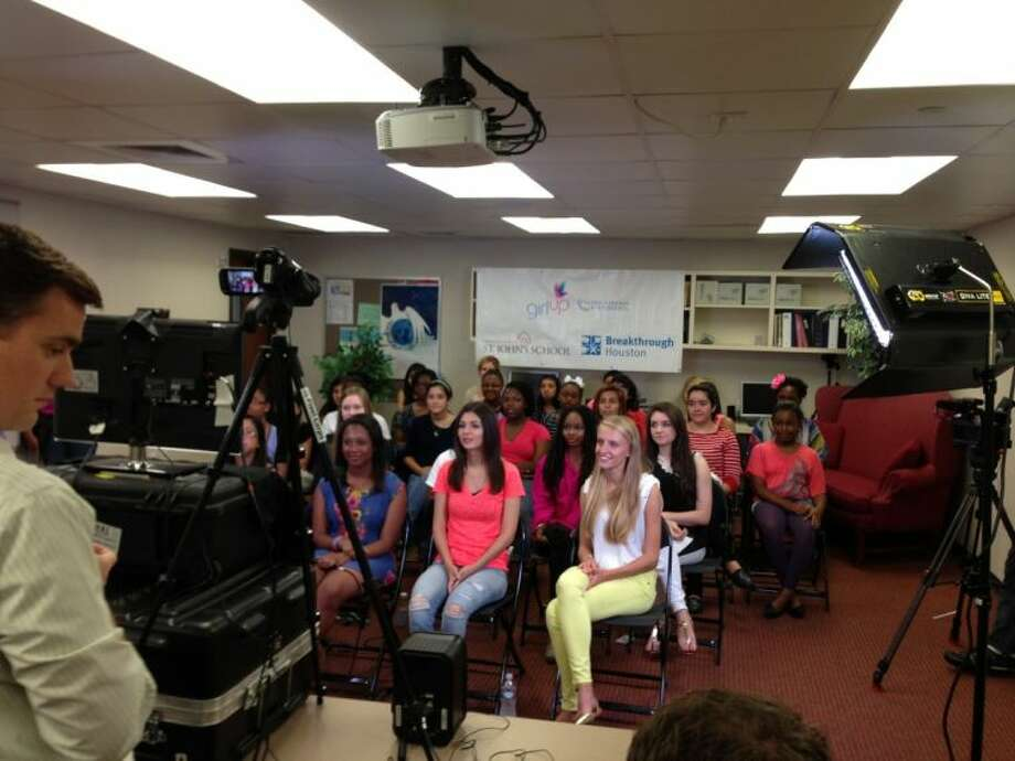 Houston teens listen to the First Lady deliver opening remarks about education and empowerment during the virtual town hall.
