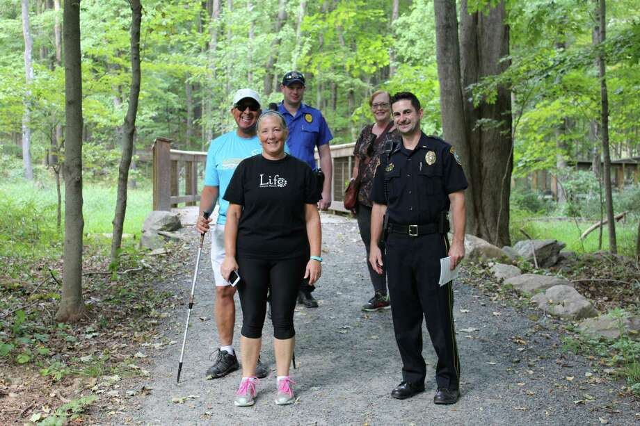 """The Wilton Police Department invited the public to """"Stroll with the Patrol"""" at the Norwalk River Valley Trail on Monday, Sept. 26, 2016. (From left to right) Front: Jamie Hewit, Lt. Rob Cipolla; Middle: Ralph Walker; Back: Officer Paul Lichtenberger, Laurie Forcade. Photo: Stephanie Kim / Hearst Connecticut Media"""
