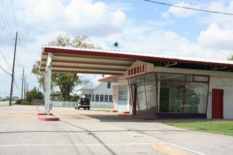 The retro appearance of the Juergens' service station is a noticeable landmark to note visitors' arrival to Cypress Top Historic Park.