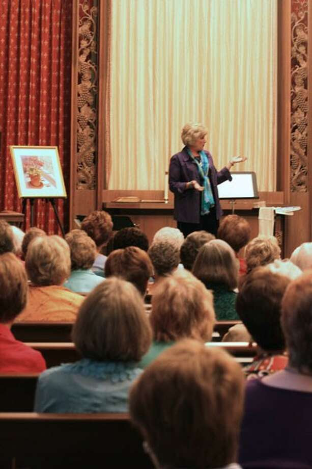 Debbie Skinner teaches a group of women the Bible while displaying her art.