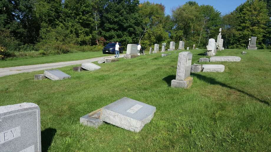 Several gravestones were toppled over between Sept. 18 and 20 at the Hill Road cemetery owned by the Immaculate Conception Church. (State Police)