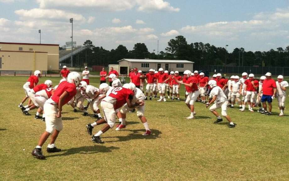 The Tomball Cougars hold practice under new head coach Danny Ramsey (blue shorts). They picked up their first ever 4A playoff victory in November, and will be looking to improve on that this coming season. Photo: David Fanucchi