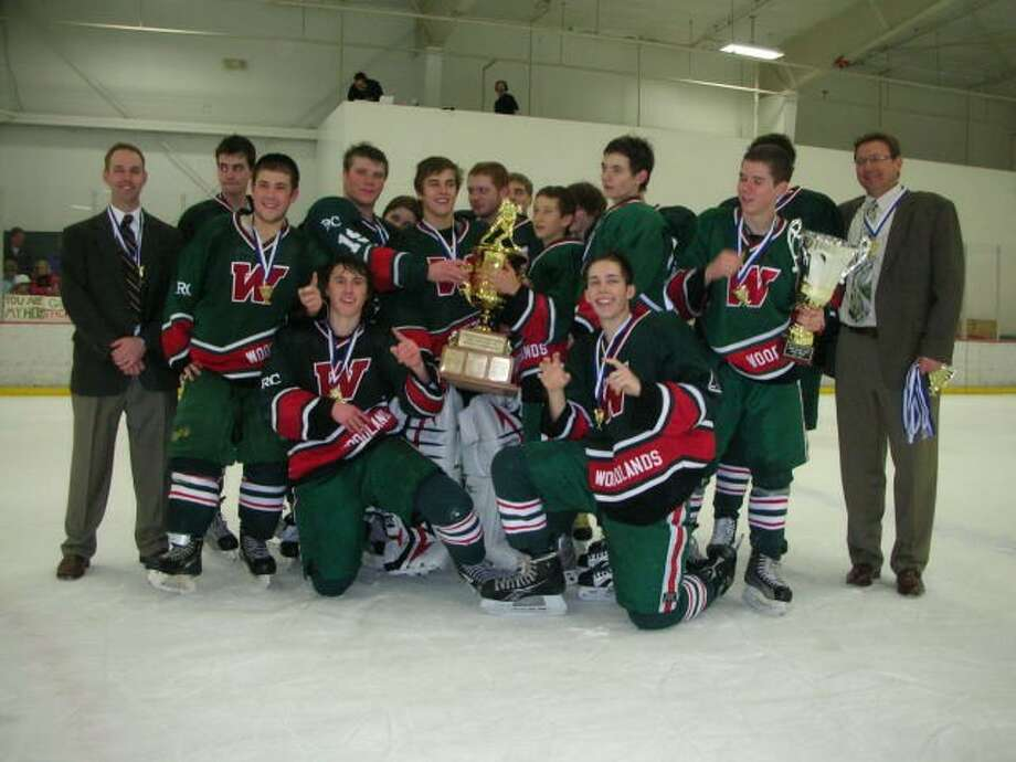 The Woodlands High school ice hockey team poses after winning the InterScholastic Hockey League championship in 2012.