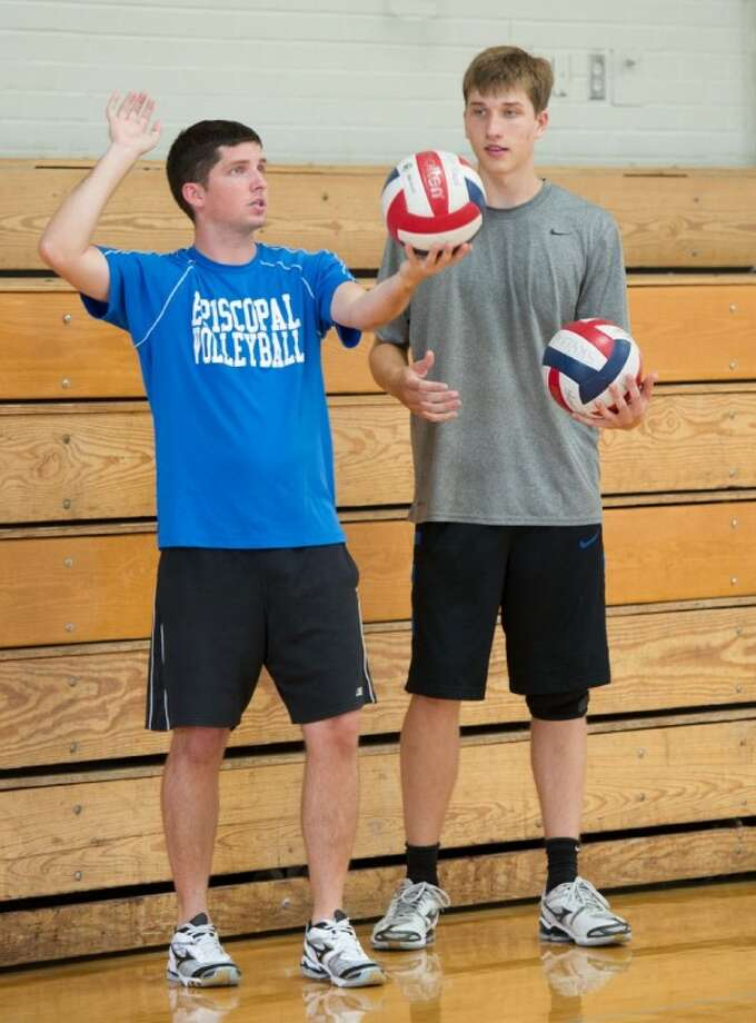 The Episcopal boys head coach volleyball coach Michael Kent, shown here working with one of his players on serves, has 10 upperclassmen on theroster this year along with six juniors and a freshman. The Knights have scrimmaged St. John's and Kinkaid but really get the season going this Friday and Saturday when they participate in the annual Houston Cup as St. John's. Photo: Kevin B Long