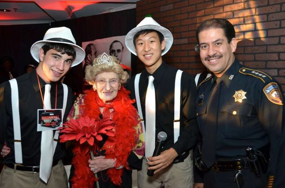From left, Senior Prom special projects advisor Stephen Proler, newly crowned Prom Queen Dorothy Freedman, emcee and lead chair Jonathan Lu and special guest Harris County Sheriff Adrian Garcia during the Roaring '20s-themed event. Photo: Roswitha Vogler