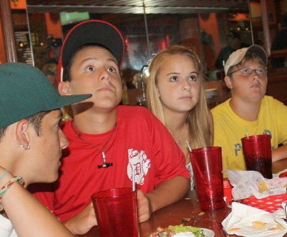 Pearland fans and team supporters were riveted by the TV coverage of the Pearland Little League game Thursday night. Game watching parties were hosted across by families and restaurants across the city. Fans at Del Pueblo Mexican Restaurant watch together, hopeful the home town team might win a slot in the Little League World Series.
