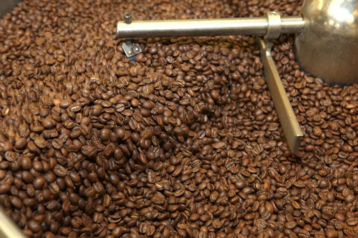 Coffee beans cool down after roasting at Java Pura Coffee Roasters in Houston.