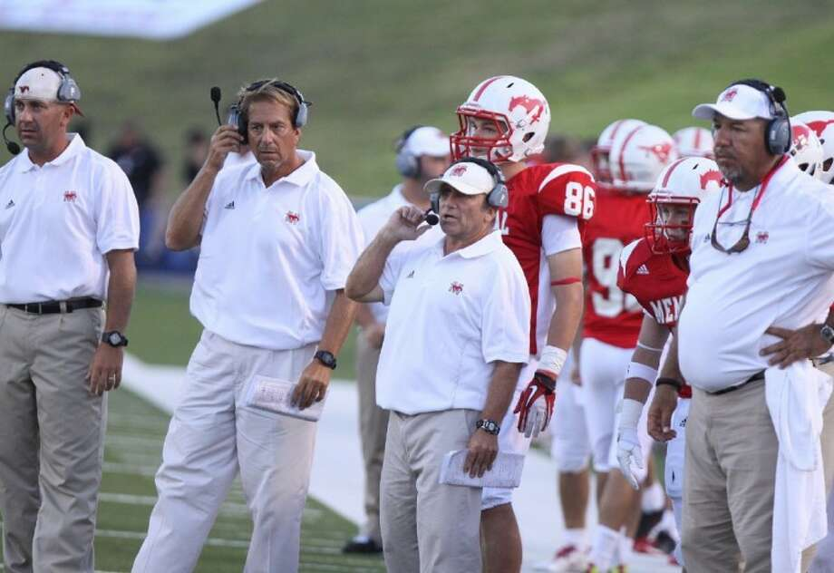 Memorial's football coaches, including head coach Gary Koch, third from the left, look on during the Mustangs' season-opening 34-14 victory over archrival Stratford Friday night at Tully Stadium. The Mustangs will go for their second win of the season this Friday evening when they play Westfield in Spring. Photo: Photo By Alan Warren