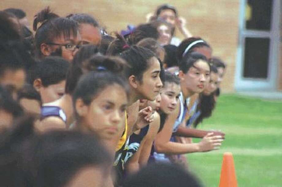 A girls intermediate school cross country race in 2012 is about to leave the starting line sometime in February. The upcoming school year will see the races taking place in their new time frame of November and December.Photo by Robert Avery/The Citizen